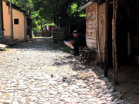 Cobbled Street With Man Reading - Serbia